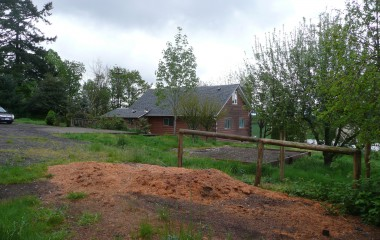 Picture of House taken from the barn view when we first moved in.